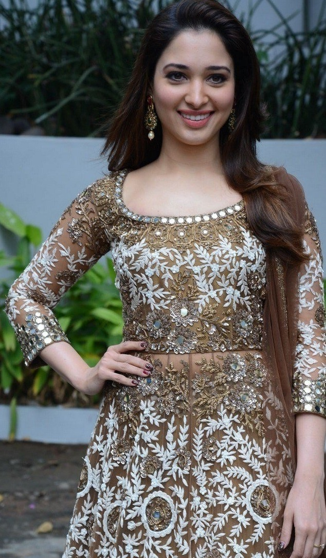 South Indian Girl Tamannaah Smiling Face Stills In Green Dress At Movie Opening