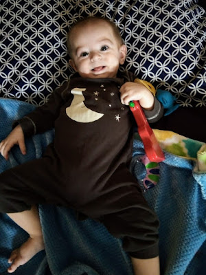Life With Baby At Six Months Old - Baby Lying On Bed With Toy