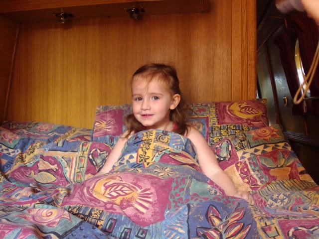 Sasha tucked up happily