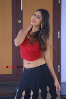 Telugu Actress Nishi Ganda Stills in Red Blouse and Black Skirt at Tik Tak Telugu Movie Audio Launch .COM 0298.JPG