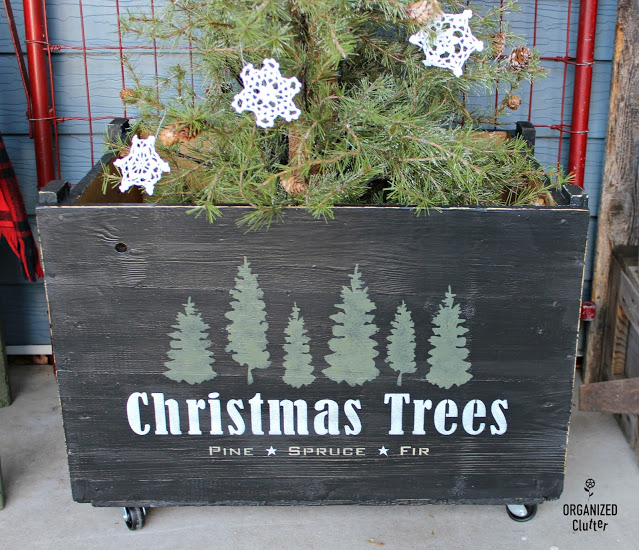 A stenciled Christmas trees crate