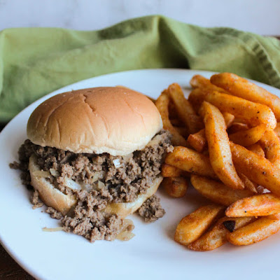maid rite sandwich on plate with seasoned fries