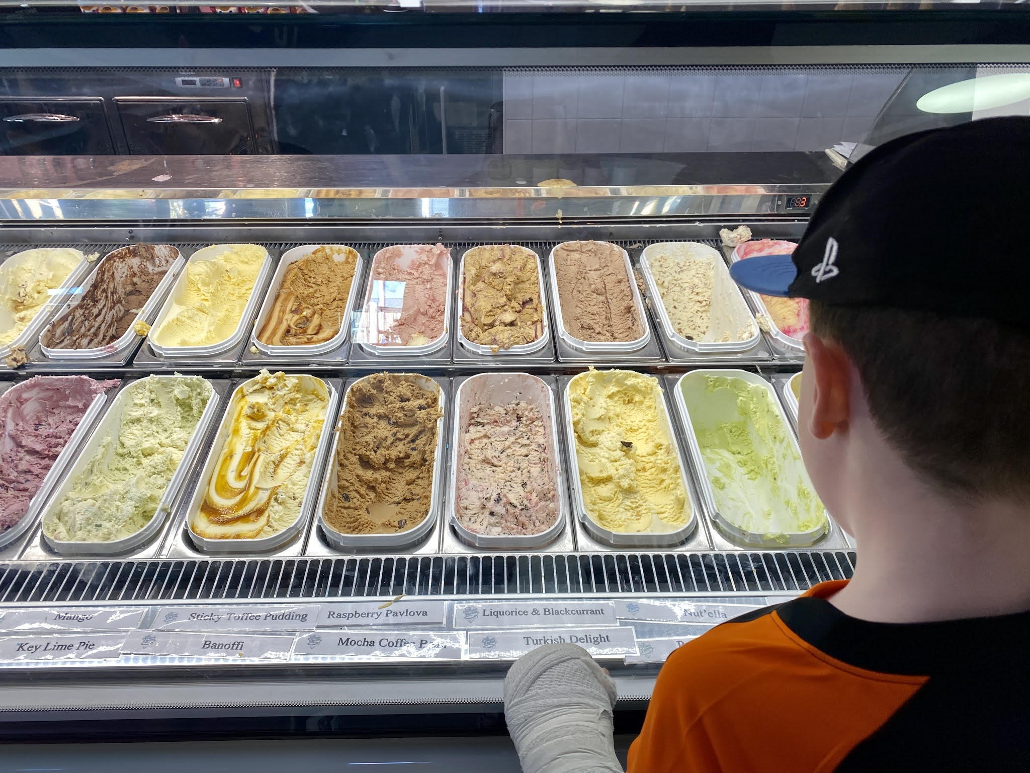 boy looking at ice cream flavours