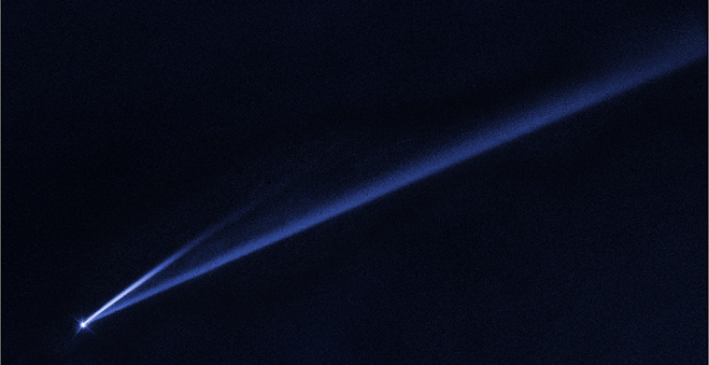 This Hubble Space Telescope image reveals the gradual self-destruction of an asteroid, whose ejected dusty material has formed two long, thin, comet-like tails. The longer tail stretches more than 500,000 miles (800,000 kilometers) and is roughly 3,000 miles (4,800 kilometers) wide. The shorter tail is about a quarter as long. The streamers will eventually disperse into space. Credits: NASA, ESA, K. Meech and J. Kleyna (University of Hawaii), and O. Hainaut (European Southern Observatory)