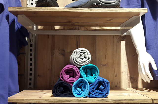 Photo of rolled up clothes in a shop
