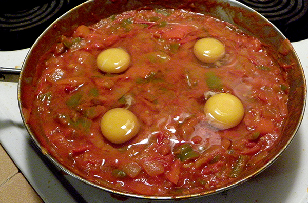 Thick tomato sauce topped with 4 eggs