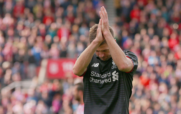 Steven Gerrard of Liverpool applauds the supporters after the Barclays Premier League match between Stoke City and Liverpool at Britannia Stadium on May 24, 2015 in Stoke on Trent, England