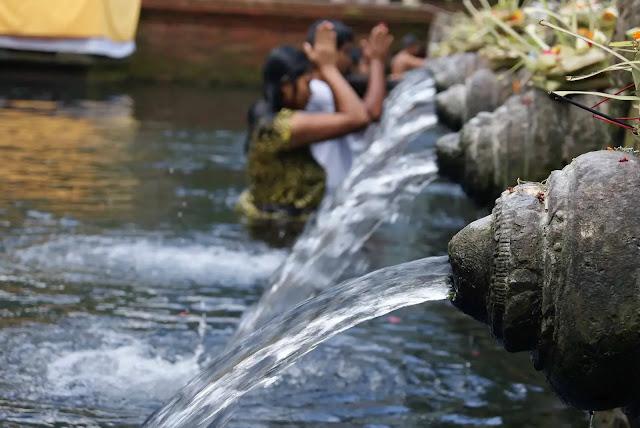 Bathed in Pura Tirta Empul Sacred stream bali, indonesia