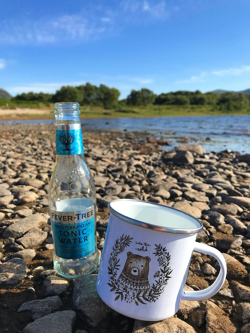 Gin and tonic in a Juniper Press mug, wild camping at Loch Hope
