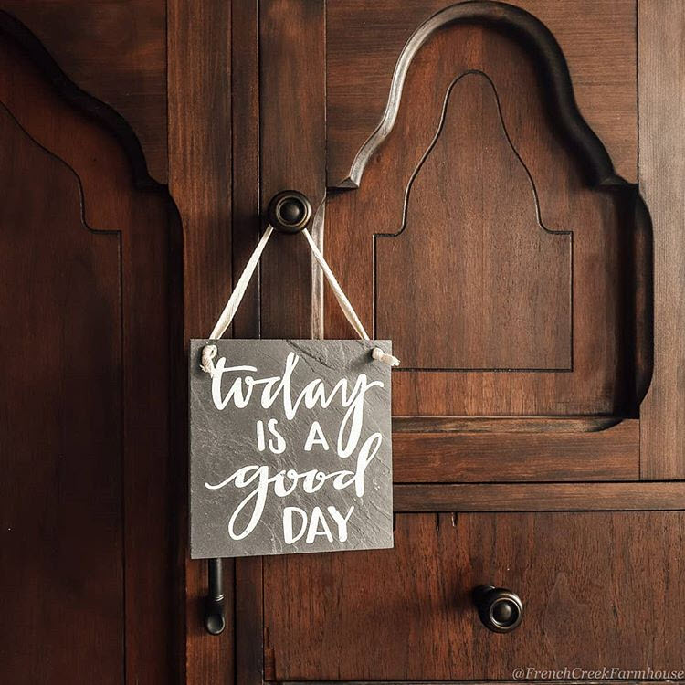 Hanging a small sign with an uplifting saying on a furniture knob makes a farmhouse chic statement