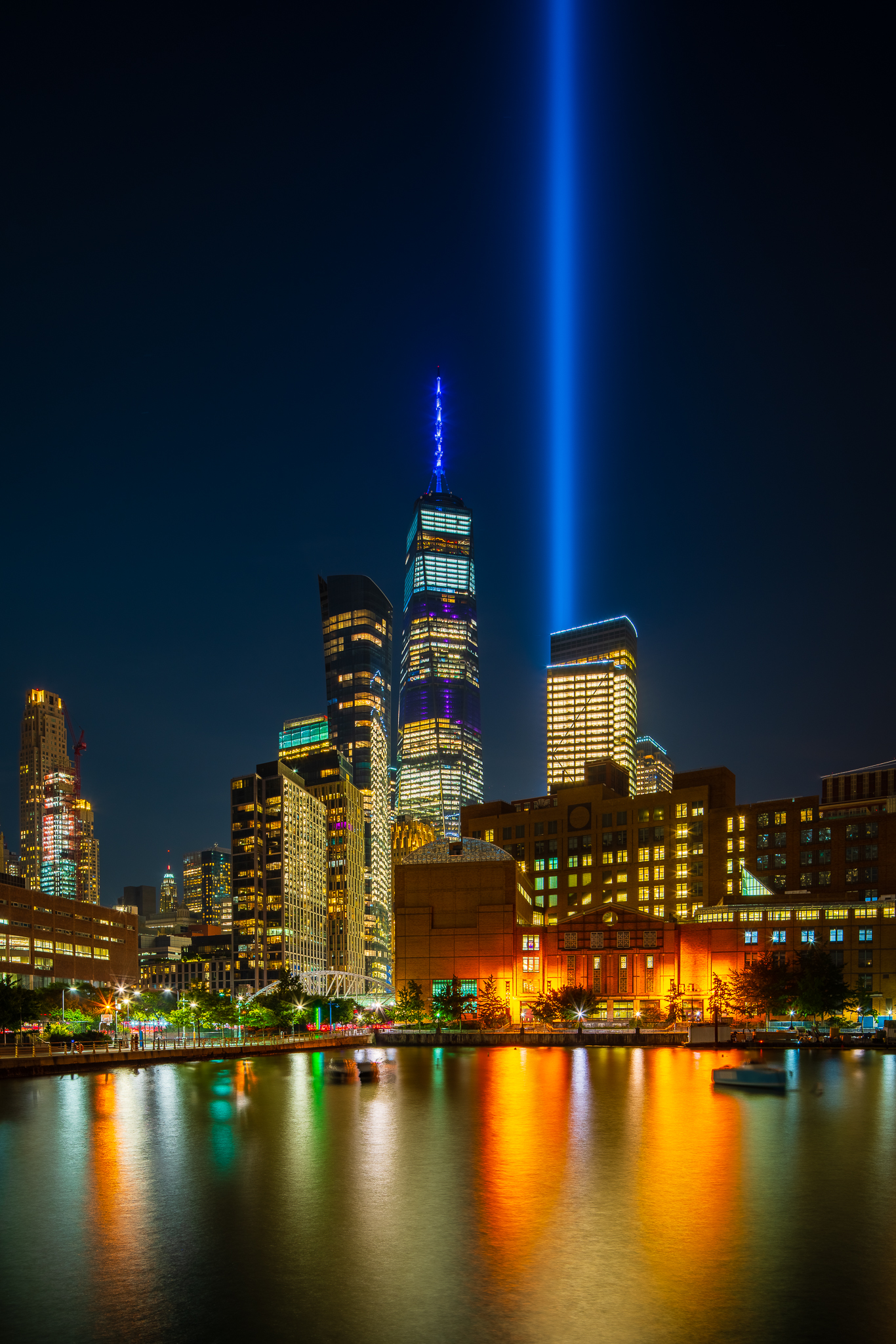 a photo of 9/11 tribute lights from the new york side of the river