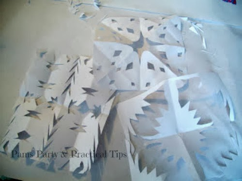 snowflakes cut from scrap paper