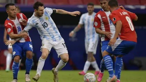 Lionel Messi earned a record-equalling 147th cap for Argentina as they progressed to the Copa America quarter-finals with victory over Paraguay.