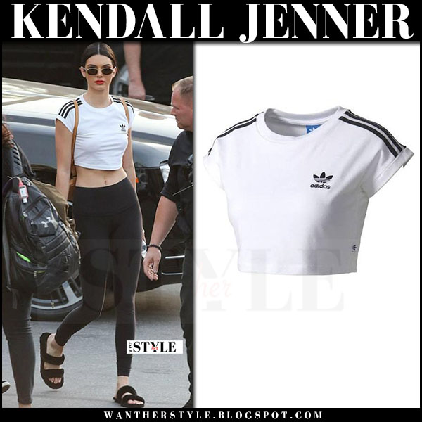 Kendall Jenner in white 3 stripe cropped top adidas and black leggings what she wore april 2017