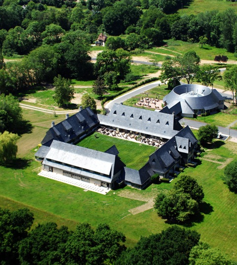 Aerial shot of Les Manoirs de Tourgéville shows the main manor house and one of five circular manors spread throughout the property's park lands. Photo: Courtesy of Les Manoirs de Tourgéville.