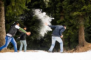 Friends enjoying snowfall in Narkanda