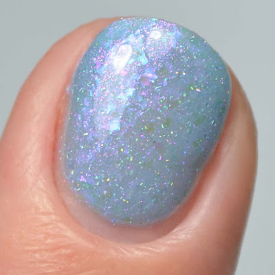 blue jelly nail polish with flakies close up