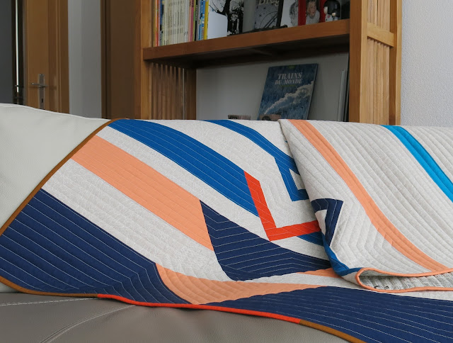 Luna Lovequilt - Horizon - A modern and minimalistic quilt - On the couch