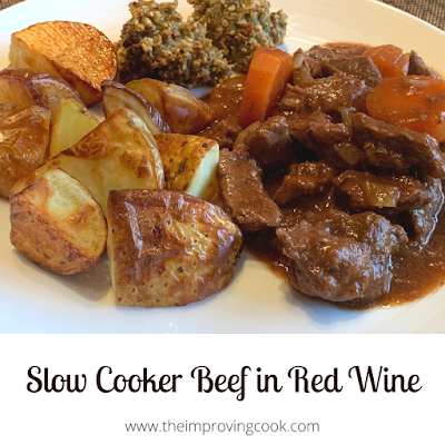 A plate with slow cooked beef, roast potatoes and stufffing