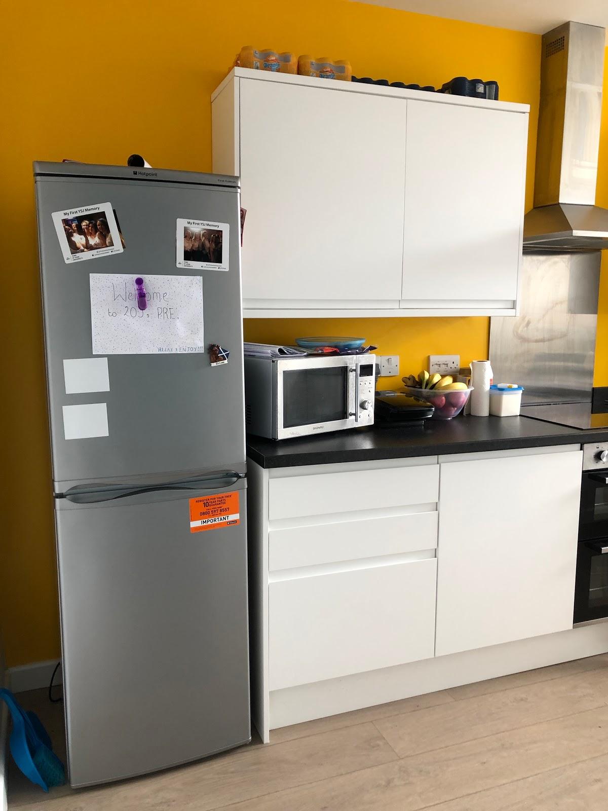 A fridge, cupboards, stove