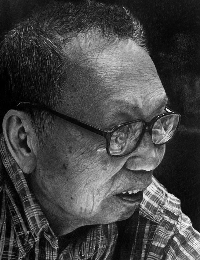 Retrato de un anciano asiatico con gafas