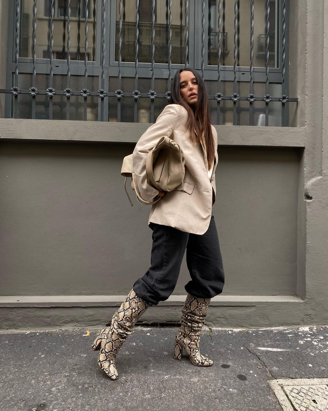 18 Best Animal Print Boots to Shop for Fall and Winter —@sarahbrezel in an oversized blazer, baggy jeans, and snake-print knee-high boots