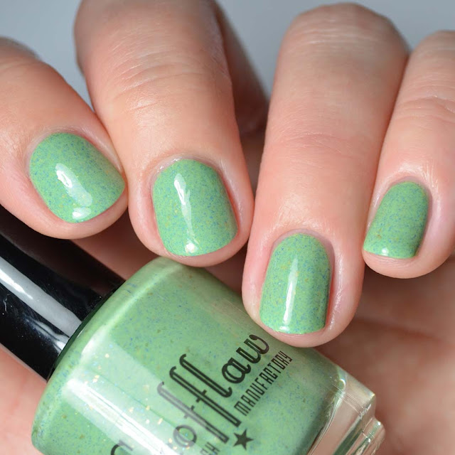green nail polish with navy shimmer