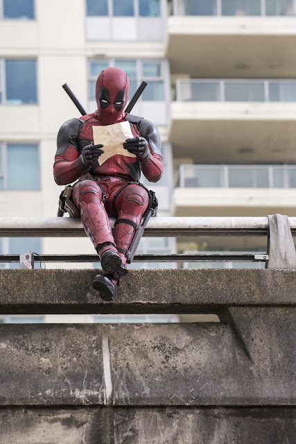 Ryan Reynolds as Deadpool relaxes before leaping into battle