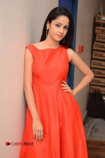 Telugu Actress Divya Nandini Stills in Orange Sleeveless Gown at Chennai Chaitrama Movie le Launch Event  0042.JPG