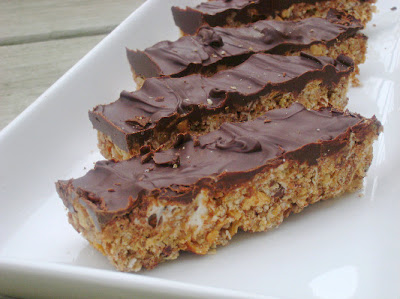 cliff bars with chocolate topping on white plate