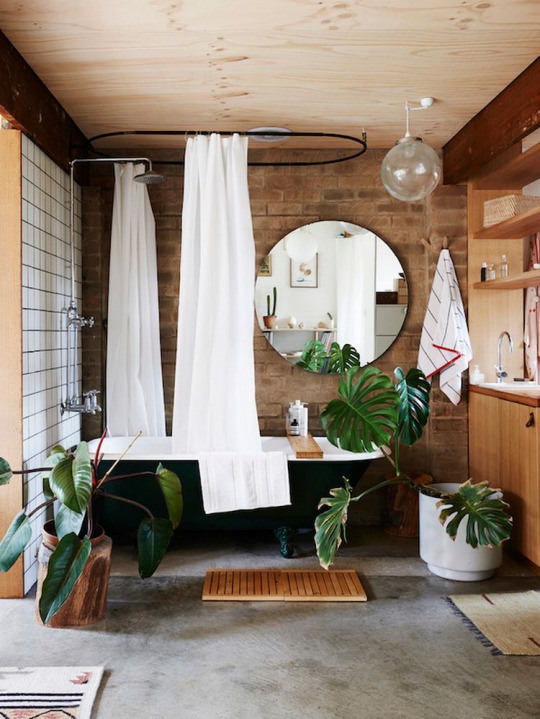 An inviting bathroom with claw foot tub.
