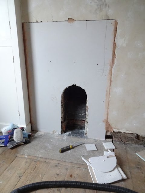 plaster boarding around a fireplace