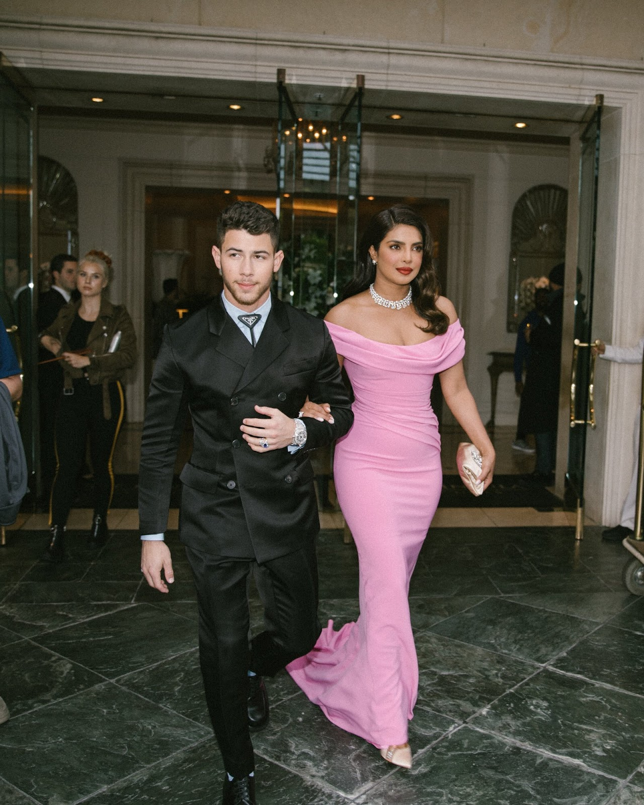 Priyanka Chopra Jonas in Christian Louboutin shoes and Bvlgari jewelry and Nick Jonas in Bvlgari jewelry