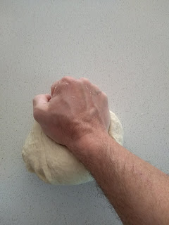 A Hand, kneading dough