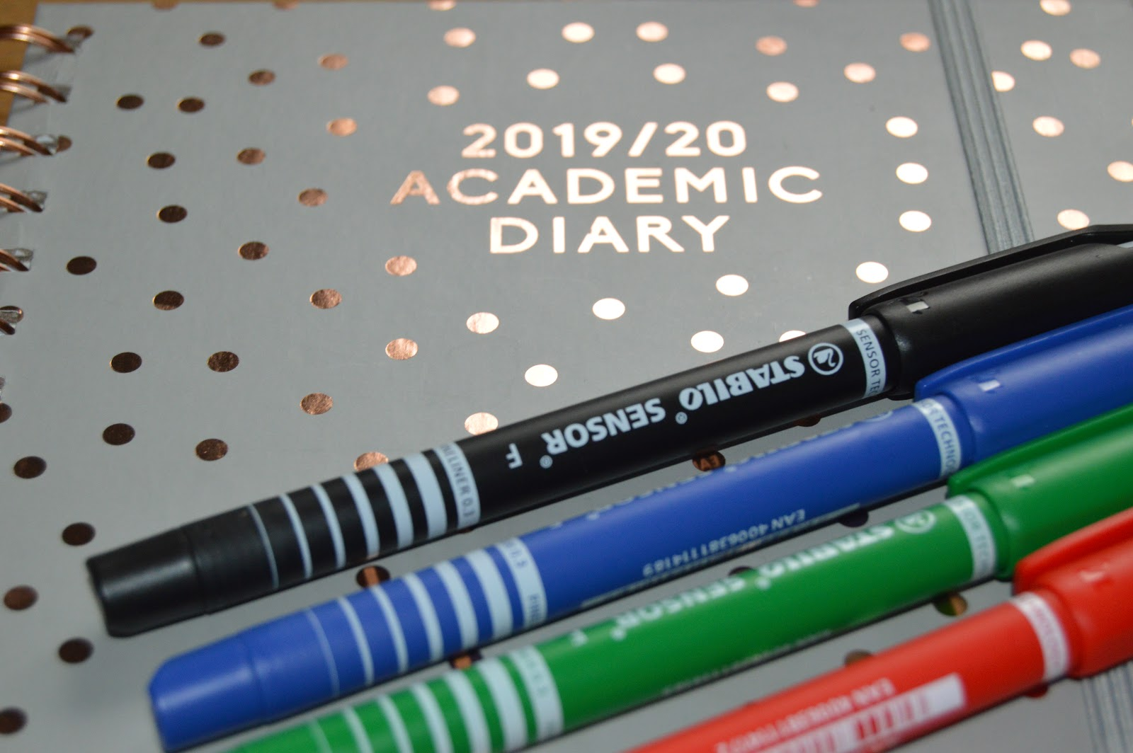 An academic diary and pens