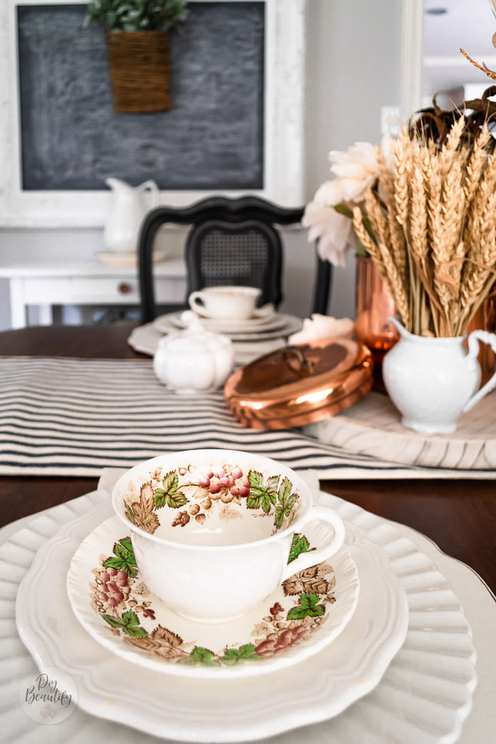 vintage teacups on fall dining table with copper accents and white ironstone