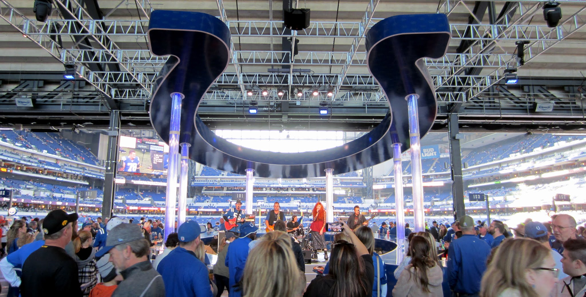 A band playing on the stage inside Lucas Oil Stadium