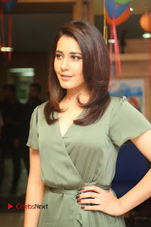 Actress Raashi Khanna Stills in Green Short Dress at Mirchi 95 Suno Aur Mercedes Jeeto Contest  0063.JPG