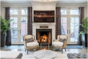 Chairs and fireplace in the center of a cozy, elegant living room