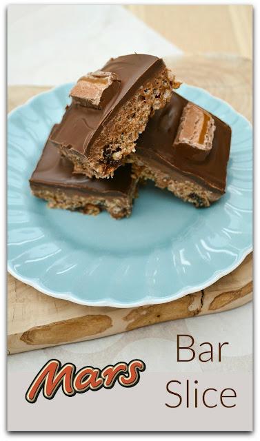 Mars Bar Slice is a Scottish retro no-bake treat made with Mars Bars. Crisp chocolate on top of a chewy caramel crispy base. #marsbars #marsbarslice #snackbars #snacks #Scottishrecipes #retrorecipes #Scottishbaking #crispiecake #ricekrispies