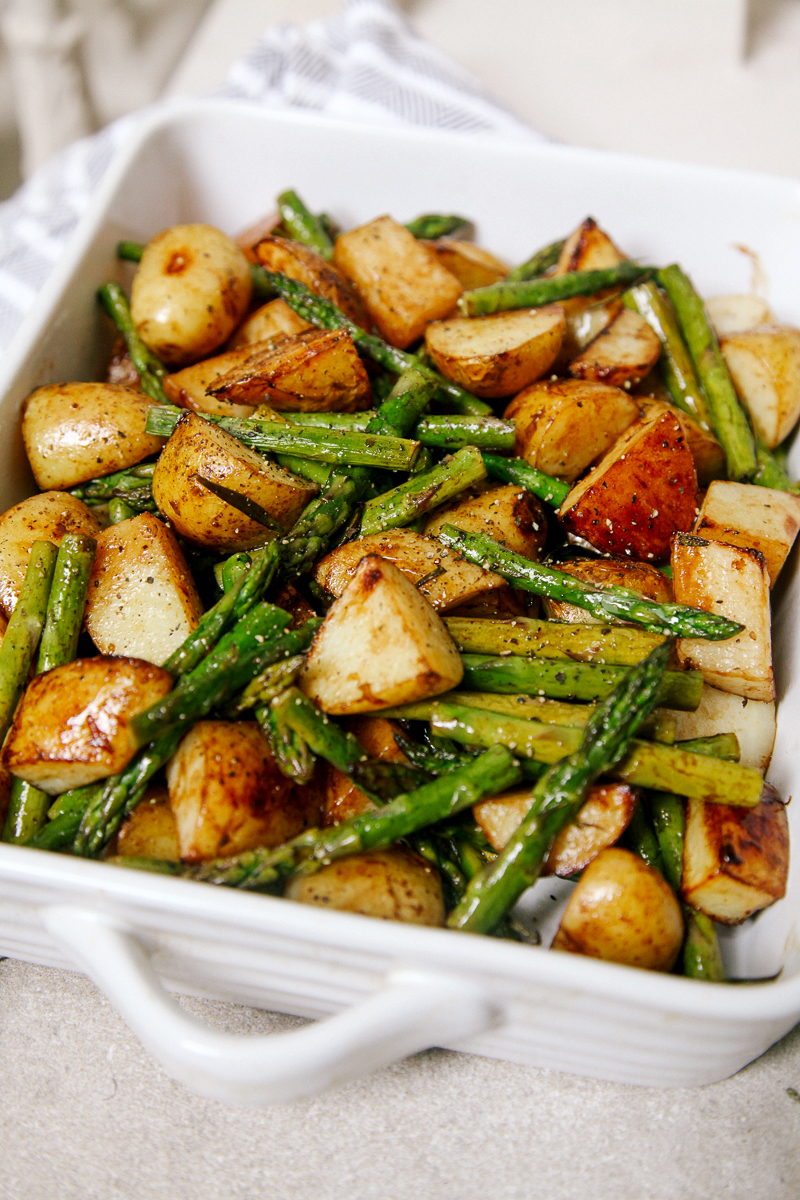 Balsamic Roasted New Potatoes with Asparagus - A simple, delicious side dish featuring seasonal asparagus and new potatoes with the subtle sweetness of balsamic vinegar.