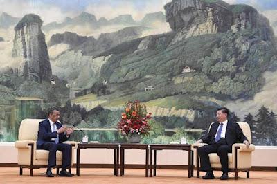 WHO & China leader