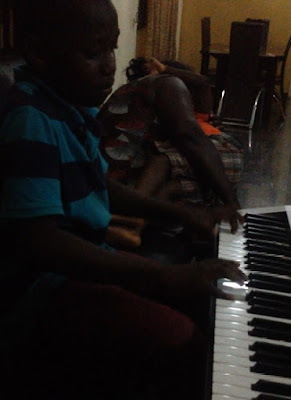 young pianist playing using solfa notation