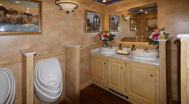 The Versailles luxury restroom trailer has a total of 11 bathroom stations