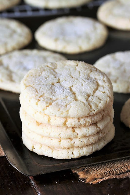 Stack of Soft & Chewy Sugar Cookies on Baking Sheet Image