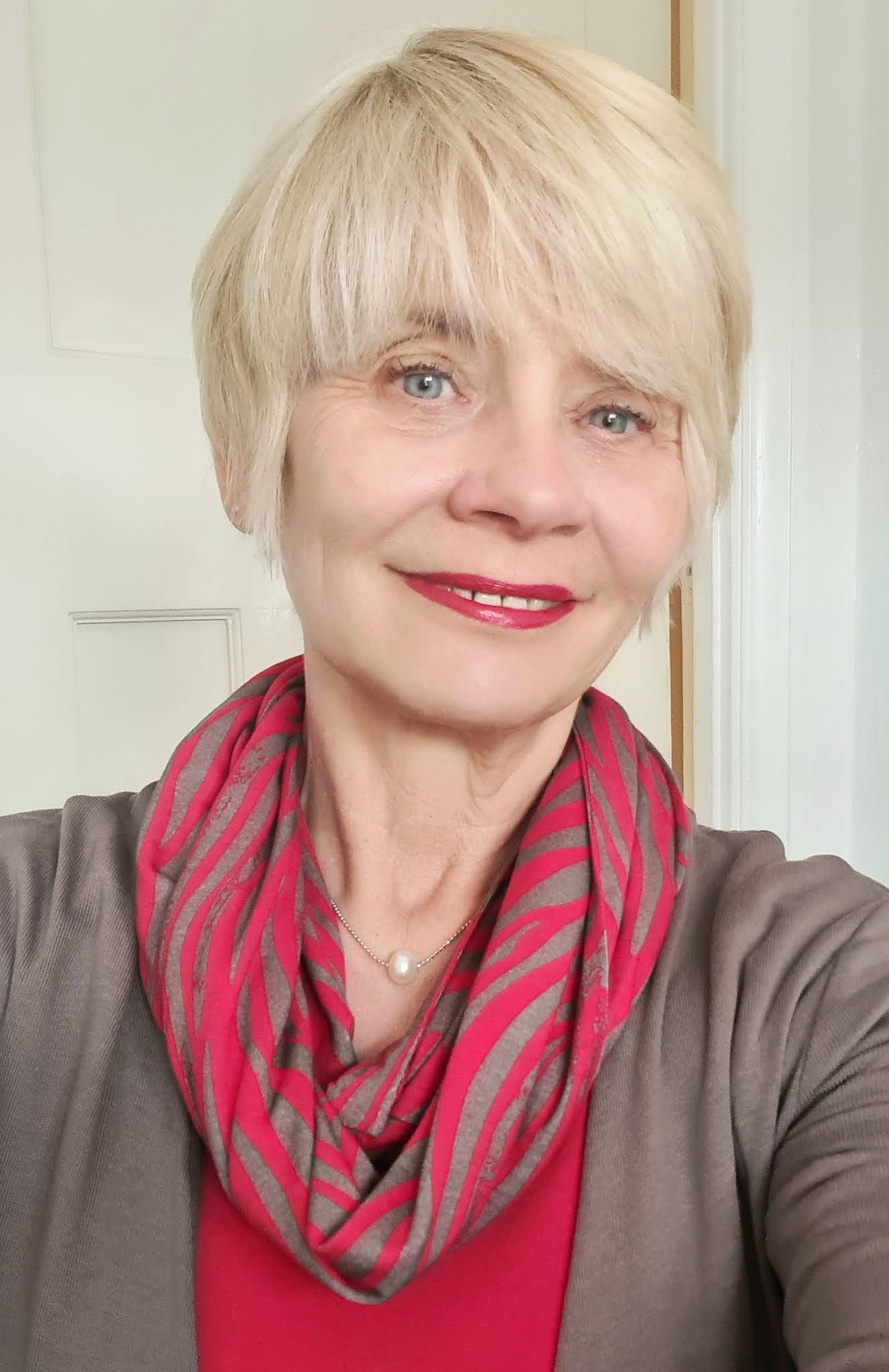 Over 50s blogger Gail Hanlon from Is This Mutton in red and beige