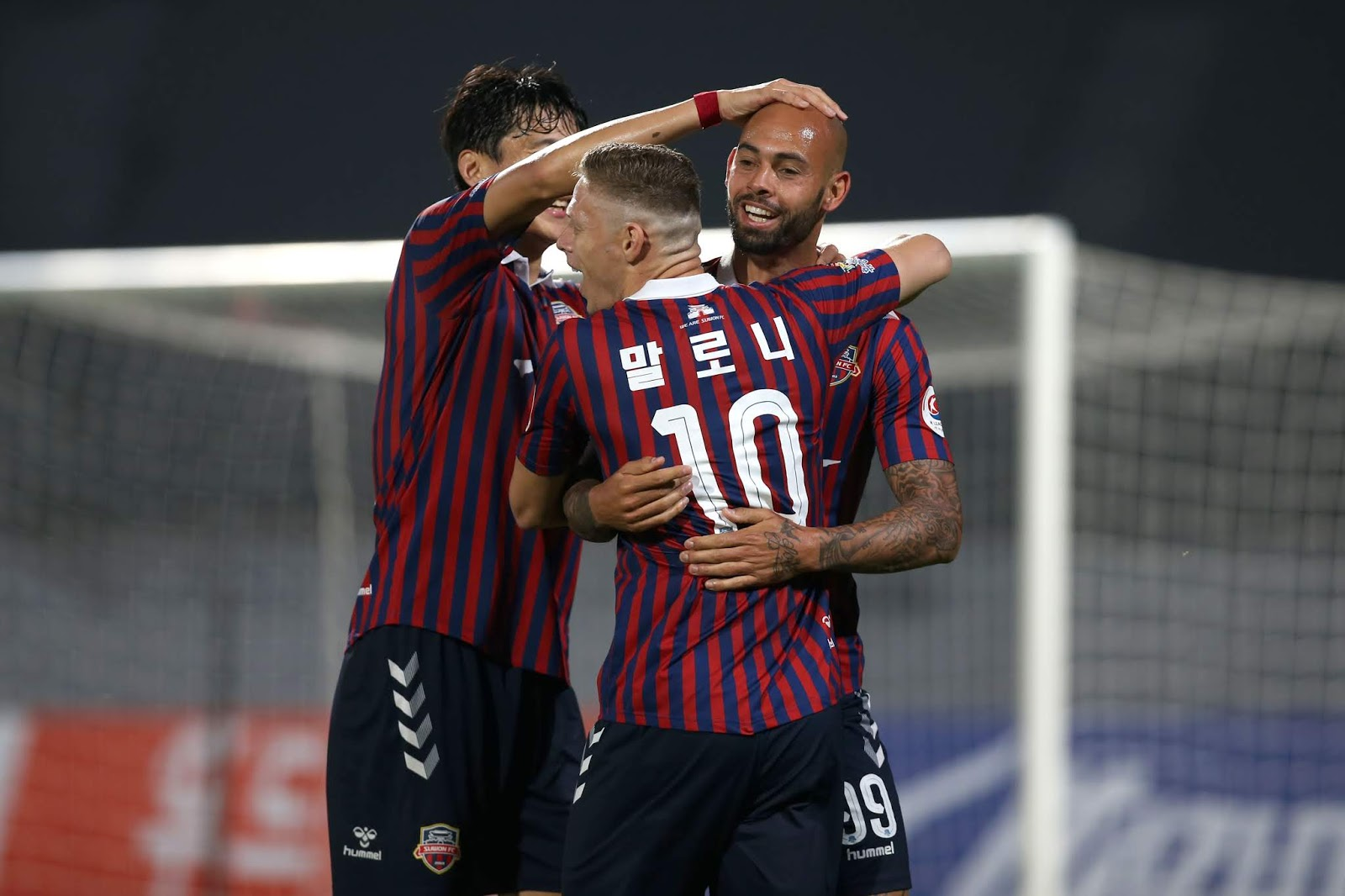 Suwon players celebrate a goal against Asan in their 5-0 win on May 24th.