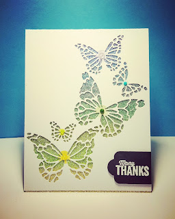Memory Box butterfly die on top of Copic colored glitter paper.  Nuvo Jewel Drops onto center of butterfly body (same color as stamped round body) following the background color of the glitter paper.  Sentiment (white embossed) and die cut banner from Stampin' Up!  Simple but eye catching design.