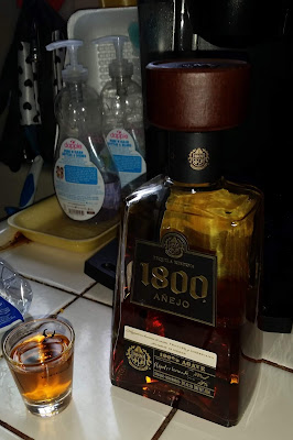 tequila shot and bottle of 1800 Anejo