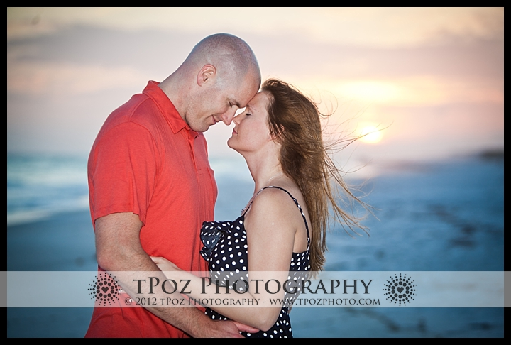 surprise engagement proposal on the beach at sunset